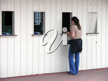Royalty Free Photo of a Woman Placing a Bet
