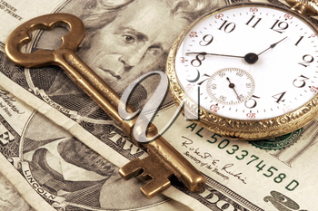 Royalty Free Photo of a Pocket Watch and Money