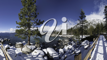 Wintry snow-covered boulders at Sand Harbor, Lake Tahoe, California, USA.