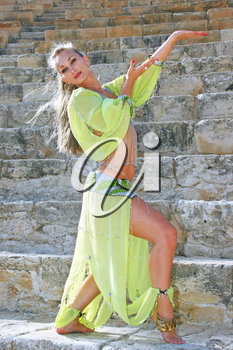 Royalty Free Photo of a Belly Dancer on the Stairs of the Kourion Amphitheatre