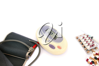 Royalty Free Photo of a Digital Blood Pressure Measurement and Pills