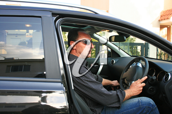 Royalty Free Photo of a Man in a Car