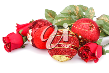 Christmas red balls and roses isolated on white background.