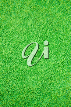 Green towel texture as a background, closeup picture.