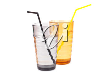 Plastic glasses with water and straw isolated on white background.