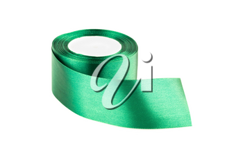 Green silk ribbon reel isolated on white background.