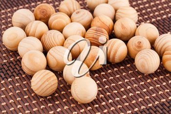 Wooden balls on bamboo background.