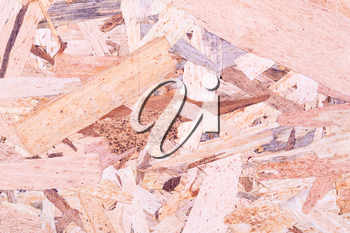 Wooden oriented strand board texture as a background.