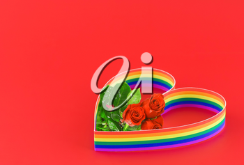 St. Valentine Day. Single heart , paint of a six-colour gay flag. On red.