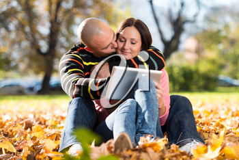 Beautiful Young Couple Using Digital Tablet