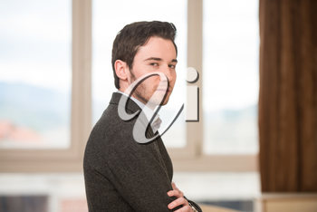 Portrait Of A Confident Young Male Teacher With Arms Crossed