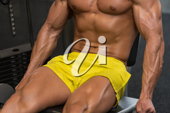 Attractive Young Man Close Up  Doing Leg Exercises With Machine In Gym