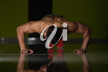 Healthy Adult Athlete Doing Push Ups As Part Of Bodybuilding Training