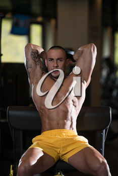 Athlete Working Out Triceps In A Gym With Dumbbell