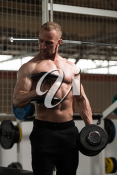 Athlete Working Out Biceps In A Gym - Dumbbell Concentration Curls