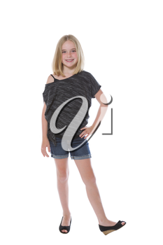Full body front view of a pretty young girl, looking forward, isolated on white
