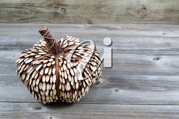 Image of pumpkin figure made of real wooden sticks on rustic wood