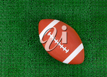 Overhead view of American football on artificial grass