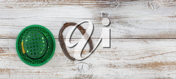 St Patricks day good luck hat and horseshoe on weathered white wood in overhead view