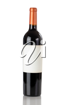 Unopen bottle of red wine isolated on a white background with reflection in close up view