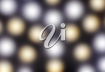 Glowing gold and silver round lights in defocused blur motion abstract background texture