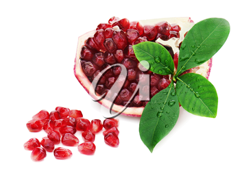 Part of pomegranate fruit with green leaves isolated on white background.