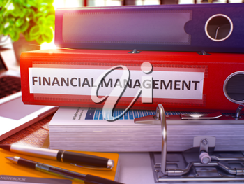 Financial Management - Red Office Folder on Background of Working Table with Stationary and Laptop. Financial Management Business Concept on Blurred Background. Financial Management Toned Image. 3D.