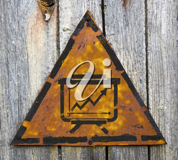 Royalty Free Photo of a Growth Chart on a Rusty Sign Against a Wall