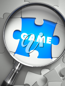 Game - Word on the Place of Missing Puzzle Piece through Magnifier. Selective Focus.