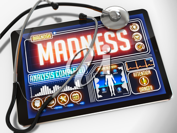 Madness - Diagnosis on the Display of Medical Tablet and a Black Stethoscope on White Background.
