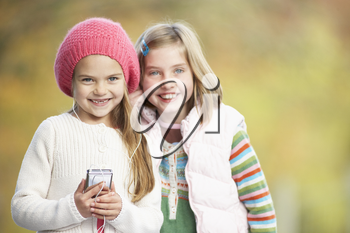 Two Young Girl Outdoors With MP3 Player
