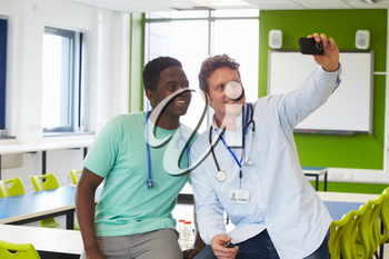 Student And Tutor Studying Medicine Taking Selfie