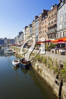 Restaurants on the waterfront of the beautiful picturesque Port of Honfleur, Calvados, Normandy, France, Europe