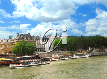 Tourist cruise boats on river Seine in Paris, France.