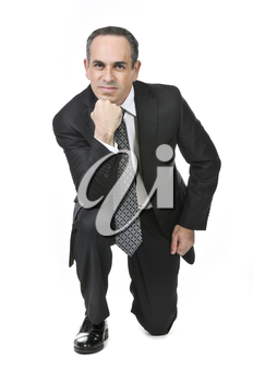 Thinking businessman in a suit isolated on white background