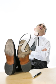 Sleeping businessman with feet up on his desk