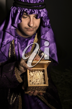 Magi with a  golden box filled with Frankincense.   Frankincense is the hardened resin of the Boswellia tree. This is frankincense from Omani which is said to be the best in the world.  Has a beautifu