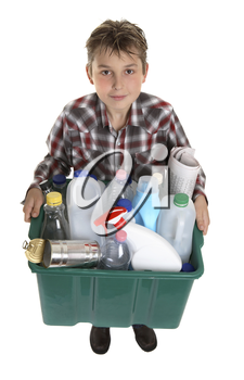 A boy with a container of suitable trash for recycling.