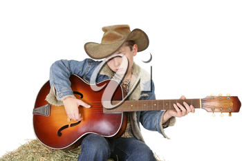 A boy strums a tune on an acoustic guitar