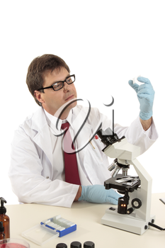 A scientist, forensic investigator,  medical worker  or laboratory researcher inspecting prepared slides under a microscope.