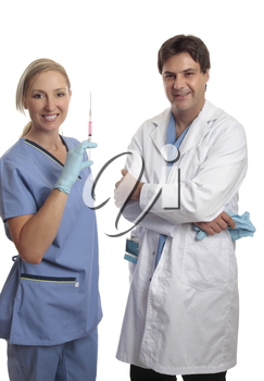 A male surgeon and female scrub nurse in uniform standing casually together.