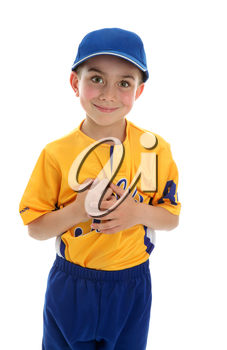 Young boy wearing a baseball or T-ball style sport outfit and blue cap.  White background.
