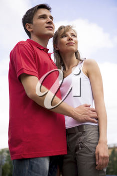 Photo of happy couple looking aside during spending time outdoors