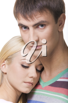 Photo of sad girl with softly closed eyes putting her head on her boyfriend shoulder while he looking at camera