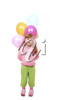 Image of small girl with helium balloons looking aside at party