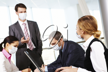 Image of business group working in the office