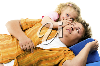 Portrait of father and his daughter lying on the bad