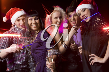 Company of friends clubbing at disco with flutes of champagne in hands