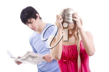 Stressed woman with touching her head on background of man reading paper