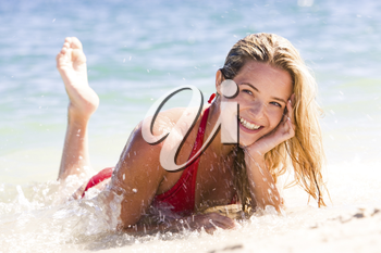 Portrait of beautiful woman doing splashes by her legs